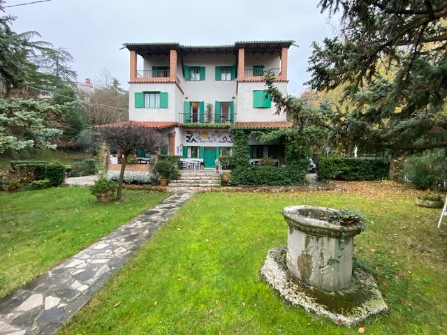 Villa Gruber Ansicht Garten Brunnen